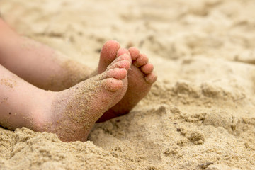 Baby's feet in the sand