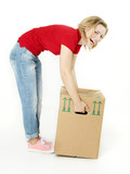 Pretty young woman has fun with her moving box