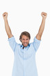 Happy man celebrating success with arms up