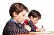 Schüler / Junge konzentriert bei der Klassenarbeit