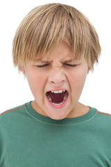 Furious little boy shouting with eyes closed