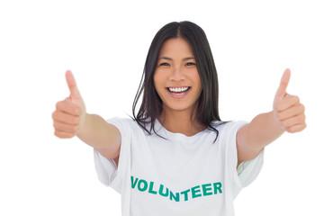 Woman wearing volunteer tshirt giving thumbs up