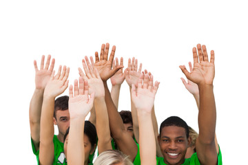 Smiling group of people raising arms