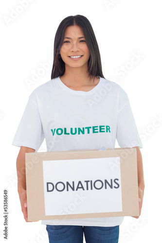 Smiling volunteer holding a donation box