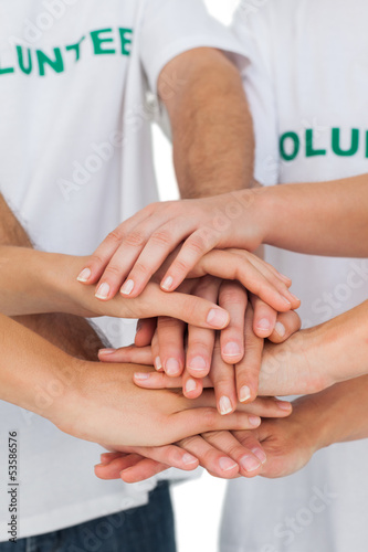 Volunteers putting hands together