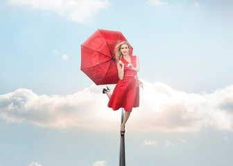 Attractive woman holding umbrella