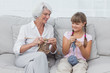 Granddaughter learning how to knit with grandmother