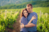 Couple in striped shirts in the vineyard