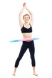 Beautiful sporty woman working out with hula hoop
