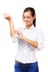 Woman in white shirt turning up sleeves