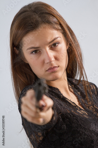 woman aiming with gun