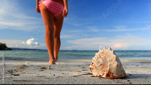Seashell and girl in bikini on beach, Philippines, Bora