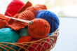 Knitwork tools and thread balls in a basket