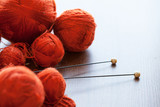 Orange knitwork with thread balls in a basket