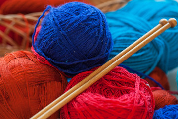 Colorful knitting thread balls on a  table