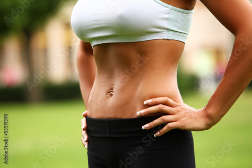 Beautiful woman's torso in a park