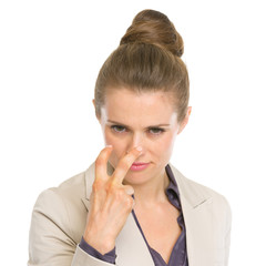 Serious business woman showing watching you gesture