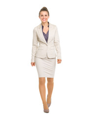 Full length portrait of happy business woman going straight
