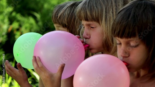 Boys inflates the balloons(close-up,profile)