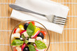 Top view of Fresh Greece Salad Served on Bamboo background