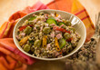 spelt sald with vegetables and ham, selective focus