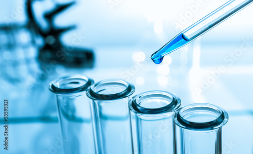 pipette and test tube on blue background