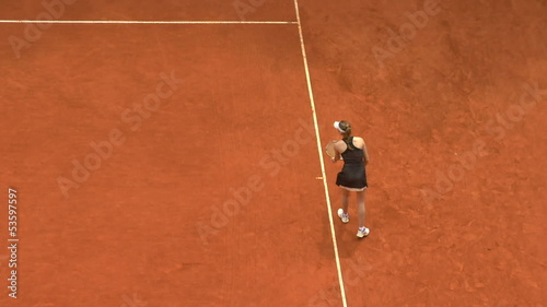 Girl play tennis outdoor on orange clay tennis court