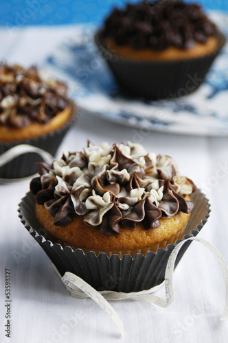 Vanilla cupcakes with creamcheese and chocolate