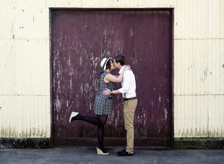 Retro young love couple kissing vintage industrial