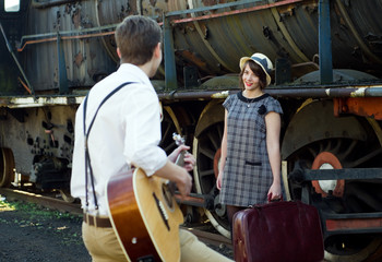 Retro young love couple vintage serenade train setting