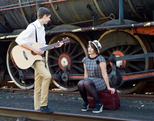 Retro young love couple vintage serenade train setting