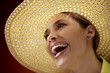 pretty woman with straw hat smiling at camera