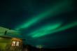 Northern lights above a cabin in Sweden