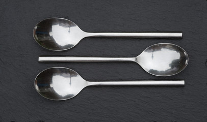 Macro image of cutlery spoons on rustic background