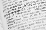 Macro image of dictionary definition of propaganda poster