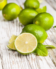 Fresh limes on wood