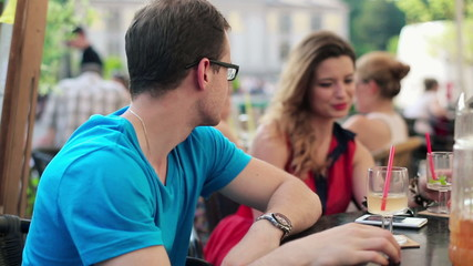 Young unhappy couple on bad date in cafe