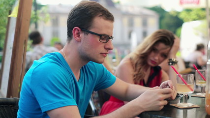 Relationship difficulties, couple sitting in cafe