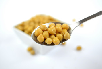 Chickpeas in small white dish with spoon