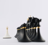 White chess pawn opposite to black ones