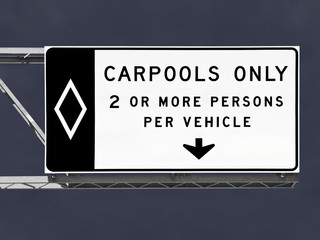 Overhead Freeway Carpool Only Sign with Storm Sky