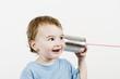 Leinwanddruck Bild - friendly child listening to tin can phone