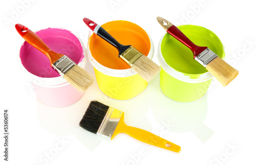 Set for painting: paint pots, brushes isolated on white