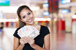 young woman holding cash outside casino