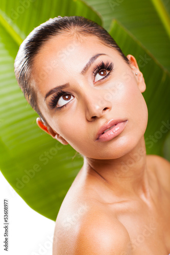 beauty woman posing on green leaf background