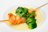 Tempura shrimps with sauce and vegetables