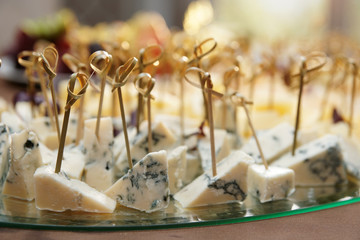 Variety of cheese on banquet table