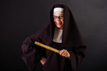 Nun with a ruler