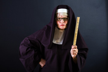Mean nun with a ruler