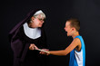 Young boy crying after being hit on knuckles by a nun
